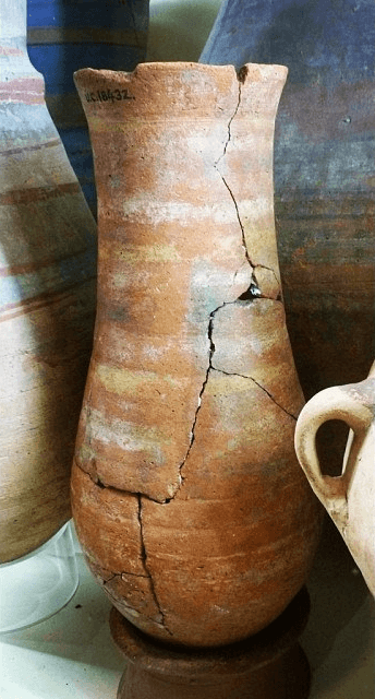 Redware pottery jar, painted white rings, broken and repaired. New Kingdom. 31.5 cm, UC18432 (Petrie Museum)