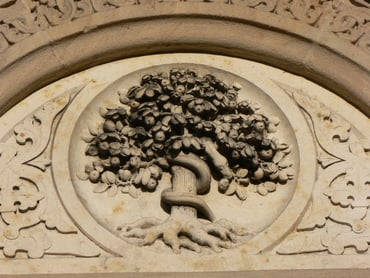 This carving of the Tree of Knowledge is on St. Johannis Kapelle (St. John the Baptist) Church in Mühldorf/Inn, Bavaria, Germany.