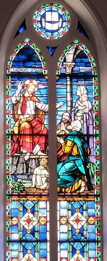 This stained glass window, at St. Matthew's Lutheran Church in Charleston, S.C., USA, shows the Word of God being shared with followers of Jesus.